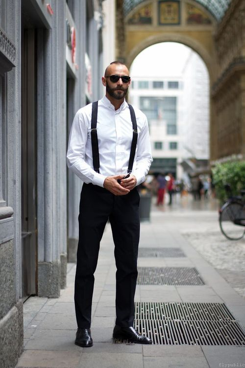 Men's suspenders serve the dual purpose of keeping your pants up and looking stylishly retro. They hang over your shoulders and feature durable clips or buttons to attach to the front and back of your pants. Many come in vibrant or dark colors to complement or contrast with your dress shirts for a classy and fashionable appearance.
