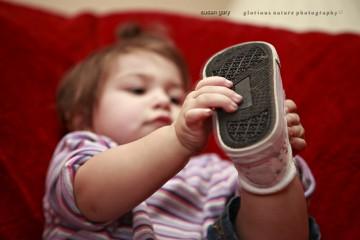 Baby Girl and Baby Shoe
