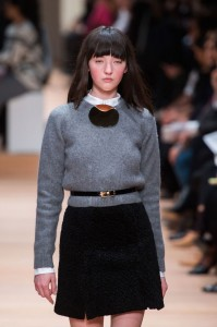 crew-neck sweater with necklace or brooch