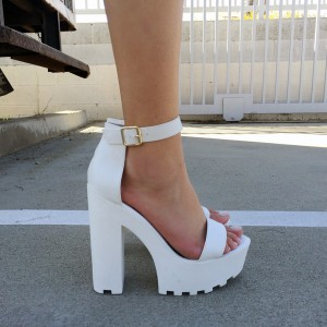 white-soled shoe