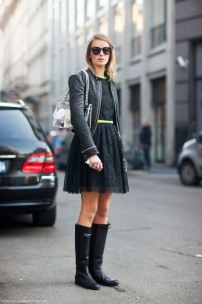 Keep your rainy day outfit edgy with a shortened black leather jacket,  black lace mini dress and rubber boots.