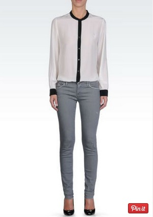 grey jeans with a graphic blouse