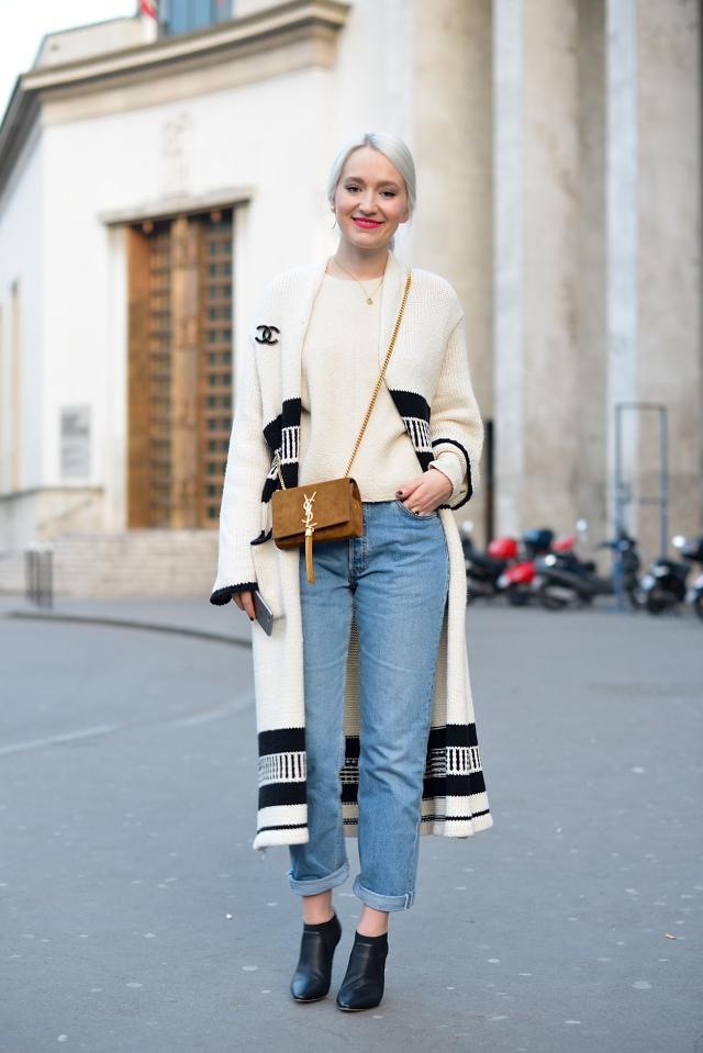PARIS, FRANCE - MARCH 09: Juliane Diesner poses wearing a Zara coat, YSL bag, Levi's pants and Jimmy Choo shoes on Day 7 of Paris Fashion Week Womenswear FW15 on March 9, 2015 in Paris, France. (Photo by Vanni Bassetti/Getty Images)